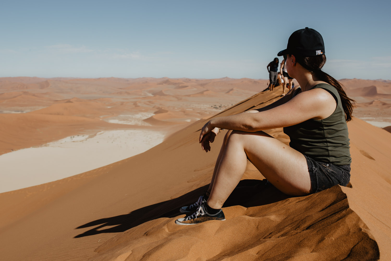 sitting-on-dunes-in-namib-desert